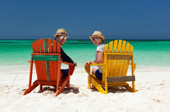 Couple at tropical beach stock photography