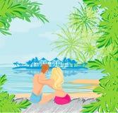 Couple on tropical beach Stock Photo