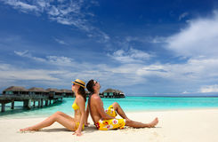 Couple on a beach at Maldives Stock Images
