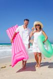 Couple on a tropical beach Stock Image