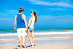 Couple on tropical beach in sunglasses in Thailand Stock Image