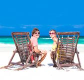 Couple on a tropical beach. Tulum, Mexico,. Honeymoon concept. This image has attached release stock images