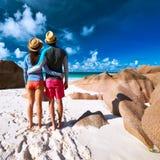 Couple at tropical beach wearing rash guard Royalty Free Stock Photo