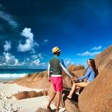 Couple at tropical beach wearing rash guard Stock Photos