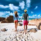 Couple at tropical beach wearing rash guard Stock Image