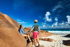 Couple at tropical beach wearing rash guard Royalty Free Stock Photos