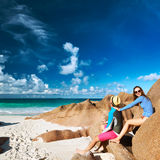 Couple at tropical beach wearing rash guard Stock Photography