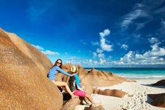 Couple at tropical beach wearing rash guard Royalty Free Stock Photos