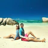 Couple at tropical beach wearing rash guard Royalty Free Stock Image