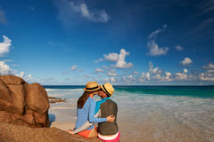 Couple at tropical beach wearing rash guard Stock Images