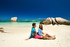 Couple at tropical beach wearing rash guard Stock Photography