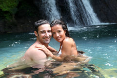 Couple in tropical island river Stock Photography