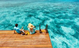 Couple at tropical resort Stock Images