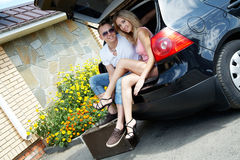 Couple in the trunk Royalty Free Stock Images