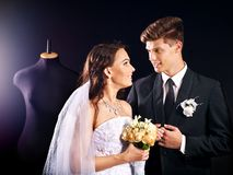 Couple try wedding dress in shop. Stock Photo