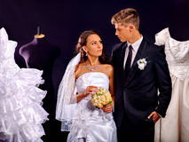 Couple try wedding dress in shop Royalty Free Stock Photo