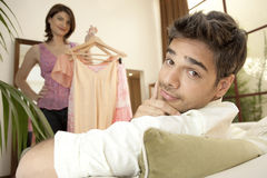 Couple Trying Clothes in Shop Royalty Free Stock Images