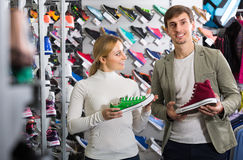 Couple trying items in the sport shop Royalty Free Stock Image