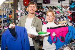 Couple trying items in the sport shop Stock Photography