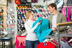 Couple trying items in the sport shop Royalty Free Stock Photos