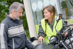 Couple trying new motorbike. Couple trying a new motorbike Royalty Free Stock Photo