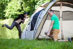 Couple trying to pitch a tent Royalty Free Stock Photography