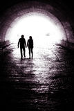 Couple on tunnel Royalty Free Stock Photo