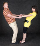 Couple is turned keeping for hands Stock Images