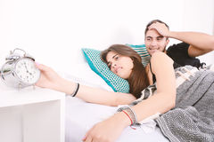 Couple turning off the alarm. Royalty Free Stock Images