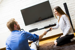 Couple with a tv remote control Stock Images
