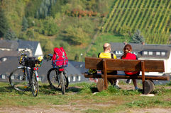 A Couple with two bicycles enjoing the landscape. A Couple with two bicycles having a breake and enjoing the landscape stock image