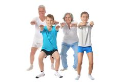 Couple with two boys. Portrait Of A Senior Couple with two boys Exercising on White Background Royalty Free Stock Images