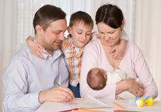 Couple with two children Stock Photo
