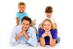 Couple with two children. In white background Royalty Free Stock Photo