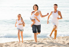 Couple with two children running Royalty Free Stock Photos