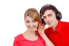 Couple two friends with headphones listening to music Royalty Free Stock Images
