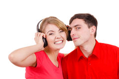 Couple two friends with headphones listening to music Stock Photos