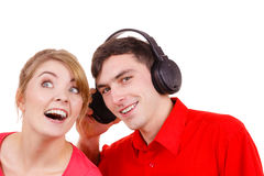 Couple two friends with headphones listening to music Stock Images