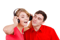 Couple two friends with headphones listening to music Royalty Free Stock Photos