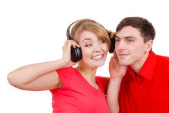Couple two friends with headphones listening to music Royalty Free Stock Photography