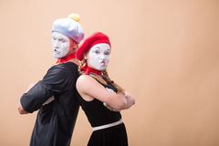 Couple of two funny mimes isolated on background Stock Photos
