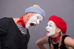 Couple of two funny mimes isolated on background Royalty Free Stock Images
