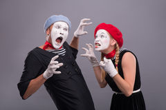 Couple of two funny mimes isolated on background stock photography