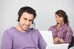 Couple with two laptops Royalty Free Stock Image