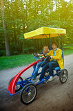 Couple on two-seat bicycle car Royalty Free Stock Photos