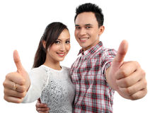Couple two thumbs up sign Stock Photo