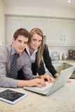 Couple typing on the notebook Royalty Free Stock Photo