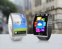 Couple ultra-thin curved screen smartwatch with metal watchband Stock Photography