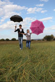 Couple Umbrella. Couple outdoors on a background of the blue sky Stock Photos