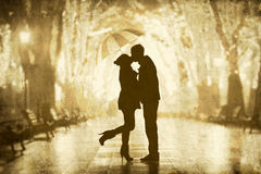 Couple with umbrella Stock Images
